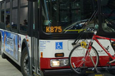 Photo of the front of a bus with the run number box displaying K875.