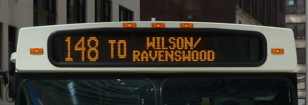 Photo of an LED destination sign on a CTA bus reading '148 TO WILSON/RAVENSWOOD'